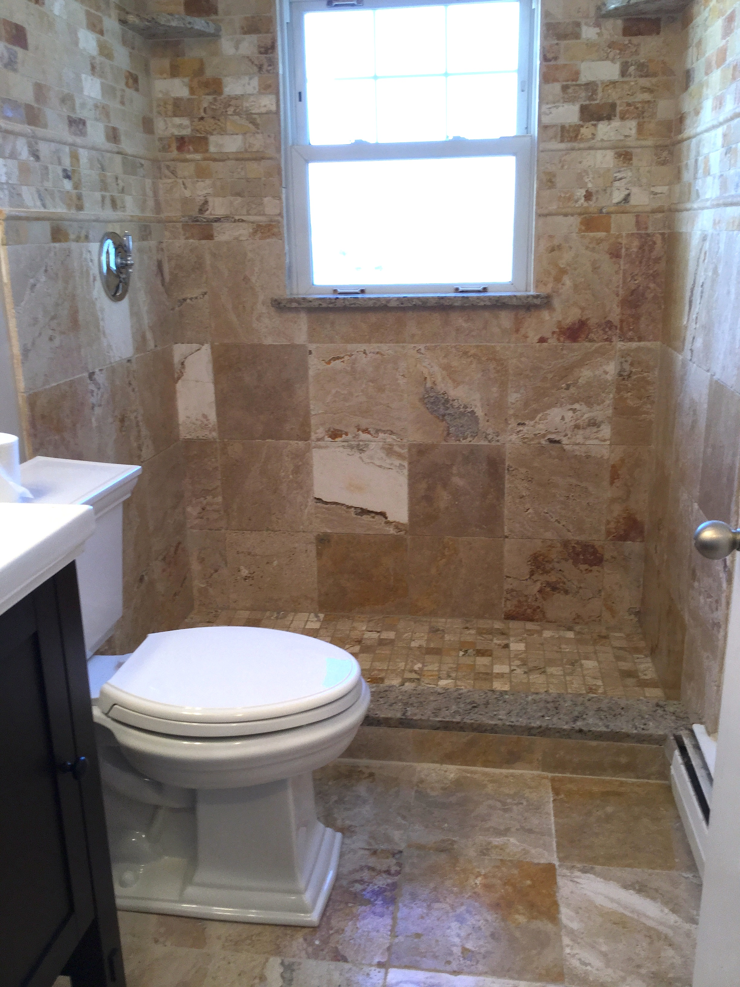 services bathrooms by design bathroom renovation remodeling complete bath remodel with tub to a shower conversion stone look different sizes of tile with granite step over shelves and matching window sill